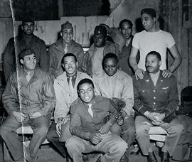 "Group picture from WWII era Tuskegee Airfield: 2nd Row, Extreme Left: Lt. George Lima, Fall River, MA, 2nd Row, Extreme Right: Hurbert ""Hooks"" Jones, Denver, CO, Center (Floor): William Neal Brown, Montclair, NJ"