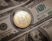 photo of cryptocurrency and paper currency