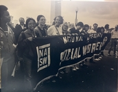 Photo of students holding banner